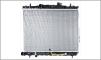 The radiator is mounted at the front of your vehicle behind the grille where it is exposed to airflow when your vehicle is at speed. Heat from the coolant in the radiator core tubes is transferred to the fins and to the air flowing through the radiator, thereby lowering the coolant temperature.